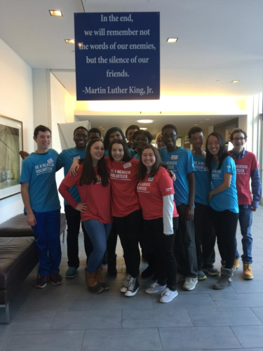 The teens of the Westchester County Youth Council pose under an inspiring banner with a quote from Martin Luther King, Jr.