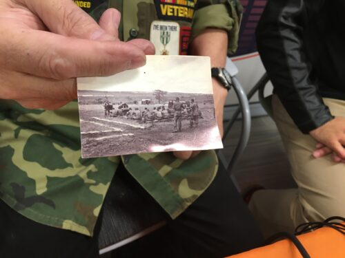 Vietnam vet displays picture of Easter Services in country