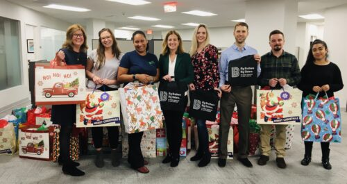 Citrin Cooperman delivers bags containing new winter coats to Big Brothers Big Sisters of Family Services of Westchester