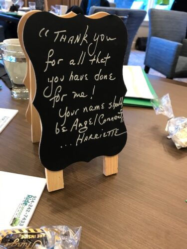 "Small blackboard that says ""thank you for all you've done for me. Your name should be Angel Connect."""