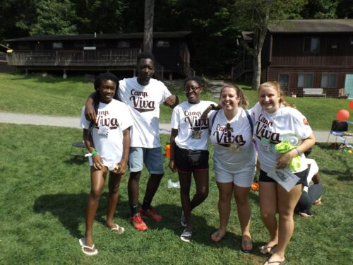 Group of camp counselors wearing Camp Viva t-shirts