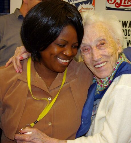 Nurse's aide hugging elderly woman