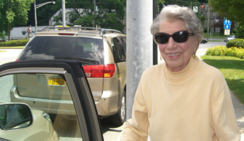 Older woman preparing to get in a car